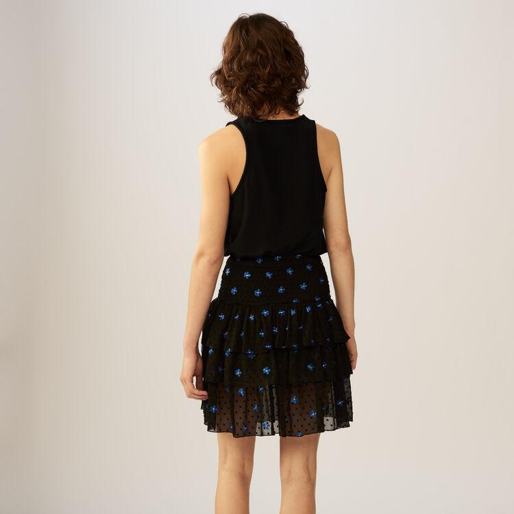 Jupe volantée en plumetis avec broderies : Jupes & Shorts couleur Black