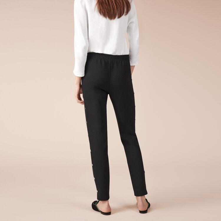 Pantalon en crêpe avec boutons pression : Pantalons couleur Black