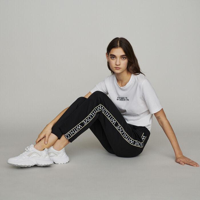 Pantalon élastiqué et bandes à message : Pantalons couleur Black