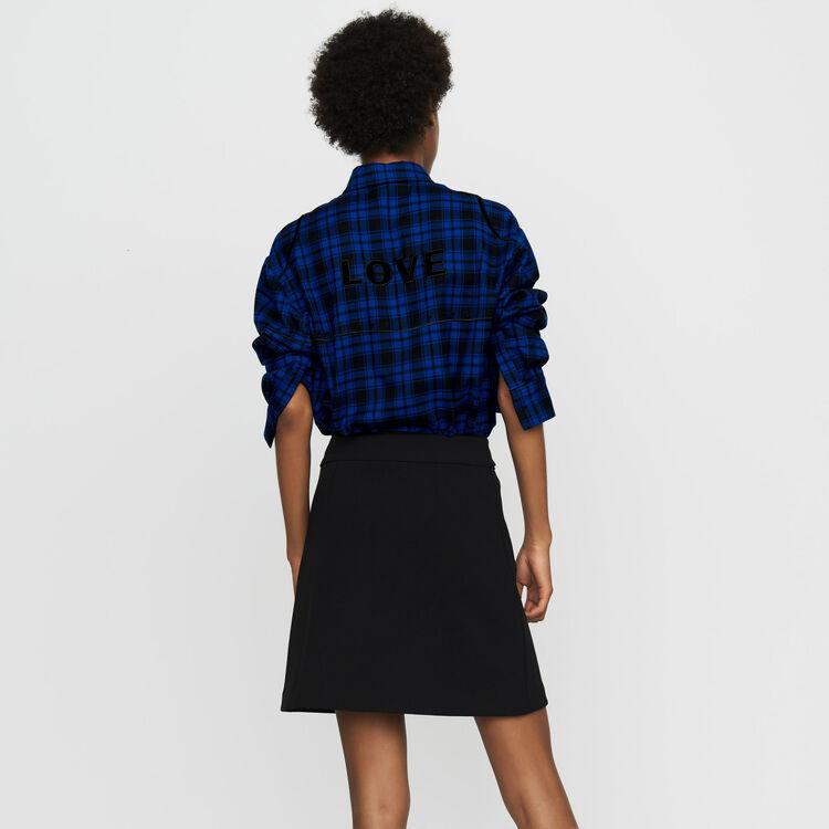Jupe courte en crêpe avec œillets : Jupes & Shorts couleur Black
